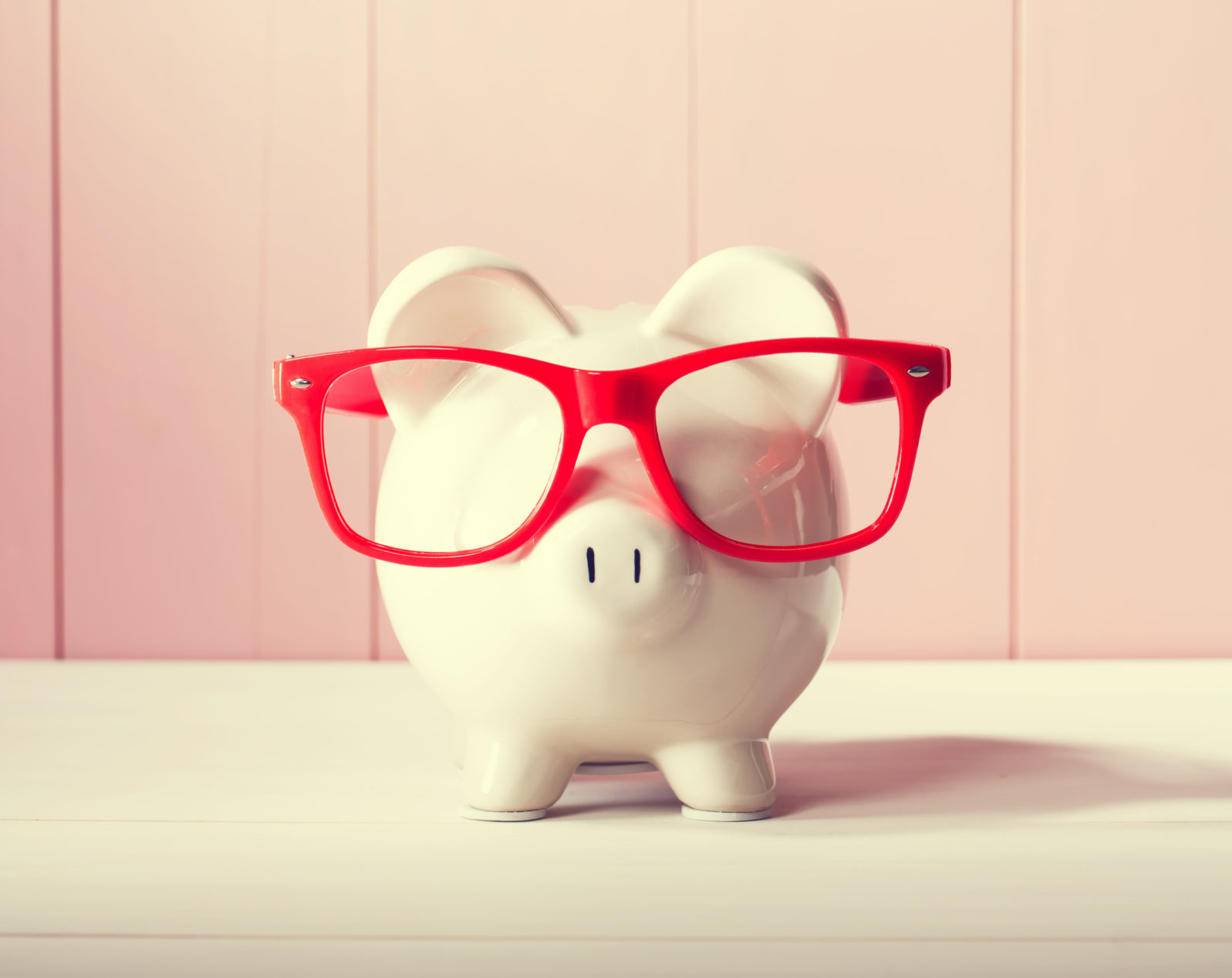 Piggy bank with red glasses